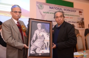 MF Husain's son presenting his father portrait to AMU Vice -Chancellor at Museology SeminarAMU ( Photograph courtesy AMU)